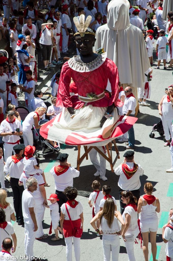 A giant dancing in the street in San Fermin